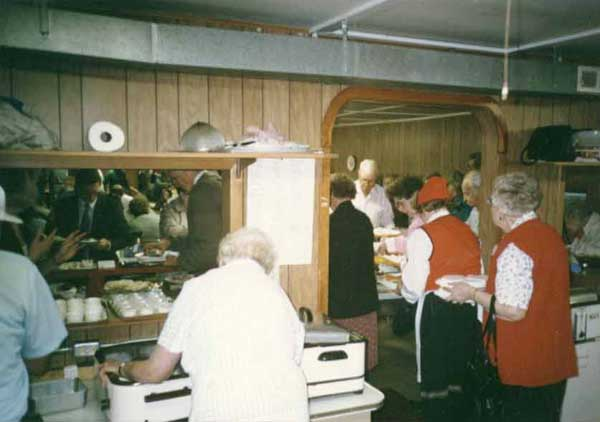 Photo of many people working at our smorgasbord.